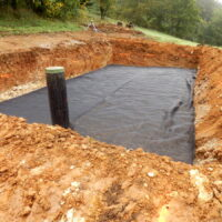Membrane laid to separate the sand from the gravel in the construction of a sand and gravel filter bed